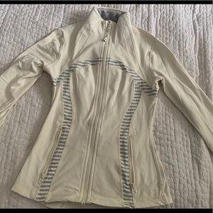 Lululemon zip up jacket in cream size 4